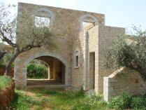 A two storey  stone house that has 120,39m2 total size. The property sits on a plot measuring 1264,63 m2