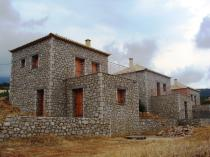 New built stone houses (100m2 each) set on a plot of land measuring \n	2000m2 with excellent views to the sea.